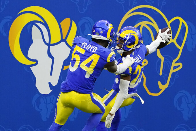 Los Angeles Rams cornerback Troy Hill, right, celebrates his fumble recovery for a touchdown with Leonard Floyd (54) during the second half of an NFL football game against the San Francisco 49ers Sunday, Nov. 29, 2020, in Inglewood, Calif. (AP Photo/Alex Gallardo)