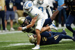 North Carolina quarterback Sam Howell (7) gets past Georgia Tech linebacker Ayinde Eley (10) to score a touchdown during the first half of an NCAA college football game Saturday, Sept. 25, 2021, in Atlanta. (AP Photo/John Bazemore)