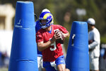 Los Angeles Rams quarterback Matthew Stafford takes part in the NFL football team's training camp in Irvine, Calif., Saturday, July 31, 2021. (AP Photo/Kelvin Kuo)