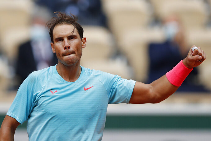 Spain's Rafael Nadal celebrates winning the second round match of the French Open tennis tournament against Mackenzie McDonald of the U.S. at the Roland Garros stadium in Paris, France, Wednesday, Sept. 30, 2020. (AP Photo/Christophe Ena)