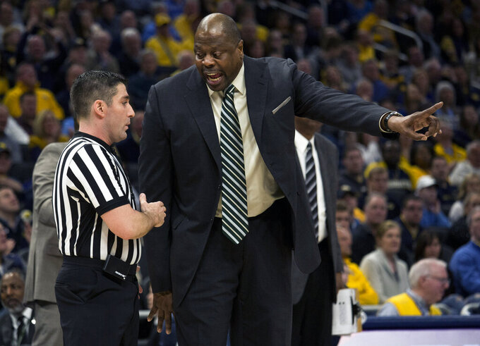 Georgetown head coach Patrick Ewing, right, argues with a referee after a foul against Marquette during the first half of an NCAA college basketball game Saturday, March 9, 2019, in Milwaukee. (AP Photo/Darren Hauck)
