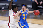 UCLA guard Jaime Jaquez Jr. (4) protects the ball from Alabama forward Juwan Gary (4) in the first half of a Sweet 16 game in the NCAA men's college basketball tournament at Hinkle Fieldhouse in Indianapolis, Sunday, March 28, 2021. (AP Photo/Michael Conroy)