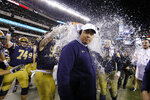 Navy head coach Ken Niumatalolo is dunked during the final minutes of an NCAA college football game against Army, Saturday, Dec. 14, 2019, in Philadelphia. Navy won 31-7. (AP Photo/Matt Slocum)