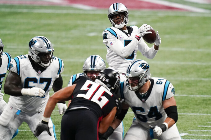 Carolina Panthers quarterback Teddy Bridgewater (5) works in the pocket against the Atlanta Falcons during the first half of an NFL football game, Sunday, Oct. 11, 2020, in Atlanta. (AP Photo/Brynn Anderson)