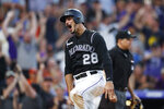Colorado Rockies' Nolan Arenado reacts after scoring on a double by Daniel Murphy off San Francisco Giants starting pitcher Madison Bumgarner in the fifth inning of a baseball game Saturday, Aug. 3, 2019, in Denver. (AP Photo/David Zalubowski)