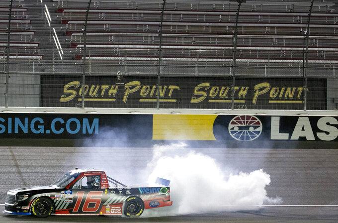 Austin Hill does a burnout after winning the NASCAR Truck Series auto race at Las Vegas Motor Speedway on Friday, Sept. 25, 2020, in Las Vegas. (Ellen Schmidt/Las Vegas Review-Journal via AP)