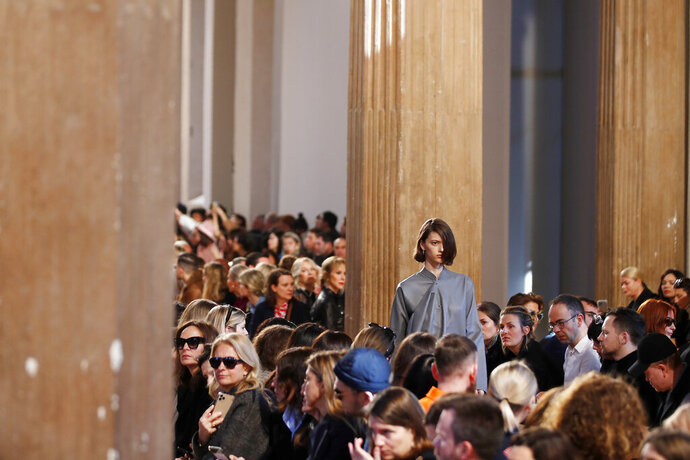 A model wears a creation as part of the Salvatore Ferragamo women's Fall Winter 2020-21 collection, unveiled during the Fashion Week in Milan, Italy, Saturday, Feb. 22, 2020. (AP Photo/Antonio Calanni)