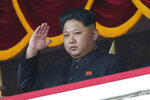 FILE - In this Oct. 25, 2015, file photo, North Korean leader Kim Jong Un gestures as he watches a military parade during celebrations to mark the 70th anniversary of North Korea's Workers' Party in Pyongyang, North Korea. For months, North Korea has been relatively uncombative, as Kim grapples with the coronavirus pandemic, a string of natural disasters and the deepening economic pain from years of tough U.S.-led sanctions. (AP Photo/Wong Maye-E, File)