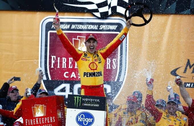Joey Logano reacts after winning a NASCAR Cup Series auto race at Michigan International Speedway, Monday, June 10, 2019, in Brooklyn, Mich. (AP Photo/Carlos Osorio)