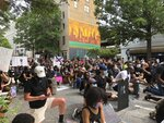 Protesters pause in a moment of silence during a march Saturday, June 6, 2020, in downtown Atlanta. Demonstrations continue across the United States in protest of racism and police brutality, sparked by the May 25 death of George Floyd in police custody in Minneapolis. (AP Photo/Jeff Amy)