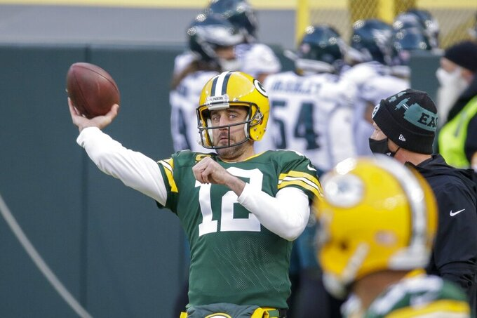 Green Bay Packers' Aaron Rodgers warms up before an NFL football game against the Philadelphia Eagles Sunday, Dec. 6, 2020, in Green Bay, Wis. (AP Photo/Mike Roemer)