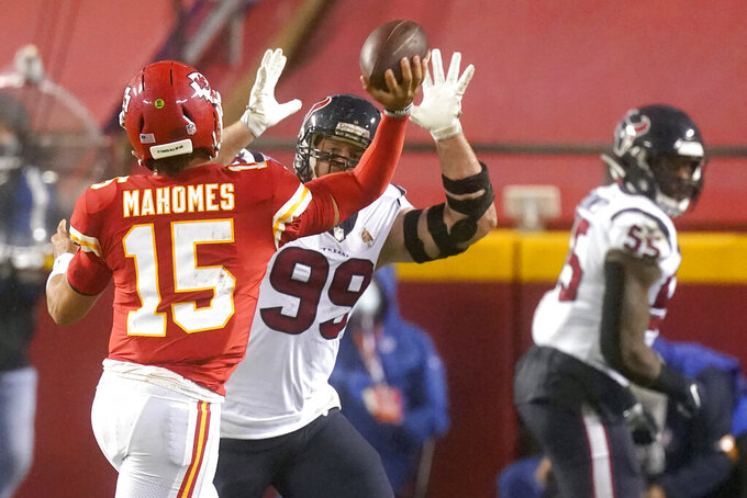 Kansas City Chiefs quarterback Patrick Mahomes (15) throws as he is pressured by Houston Texans defensive end J.J. Watt (99) in the second half of an NFL football game Thursday, Sept. 10, 2020, in Kansas City, Mo. (AP Photo/Charlie Riedel)