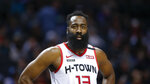FILE - In this March 7, 2020, file photo, Houston Rockets guard James Harden stands on the court during a break in the action against the Charlotte Hornets during the second half of an NBA basketball game in Charlotte, N.C. This season's NBA MVP has won the award before. A trio of past winners of the award — reigning MVP Giannis Antetokounmpo of the Milwaukee Bucks, four-time MVP LeBron James of the Los Angeles Lakers and 2017-18 winner James Harden of the Houston Rockets — were announced Saturday, Aug. 8, 2020, as the finalists for this season's top NBA individual honor. (AP Photo/Nell Redmond, File)