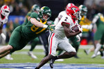 Georgia defensive back Richard LeCounte (2) returns an interception as Baylor tight end Christoph Henle (87) tries to tackle him during the first half of the Sugar Bowl NCAA college football game in New Orleans, Wednesday, Jan. 1, 2020. (AP Photo/Brett Duke)
