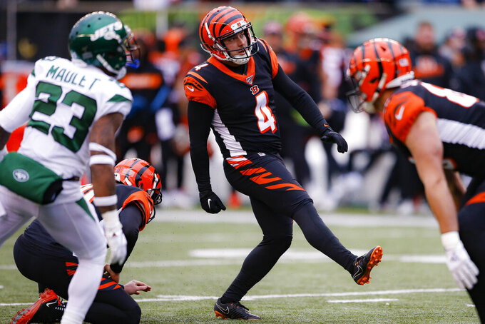 Cincinnati Bengals' Randy Bullock (4) watches his extra-point kick during the first half of an NFL football game against the New York Jets, Sunday, Dec. 1, 2019, in Cincinnati. (AP Photo/Gary Landers)