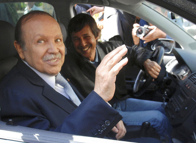 FILE - This Friday April 10, 2009 file photo shows Algerian President Abdelaziz Bouteflika, left, and his brother Said Bouteflika arrives at his campaign headquarters in the Hydra district of Algiers, a day after the Algerian presidential election. A military tribunal has opened the high-profile trial of Said Bouteflika and two ex-intelligence chiefs, one whose name alone once made Algerians tremble. (AP Photo, File)