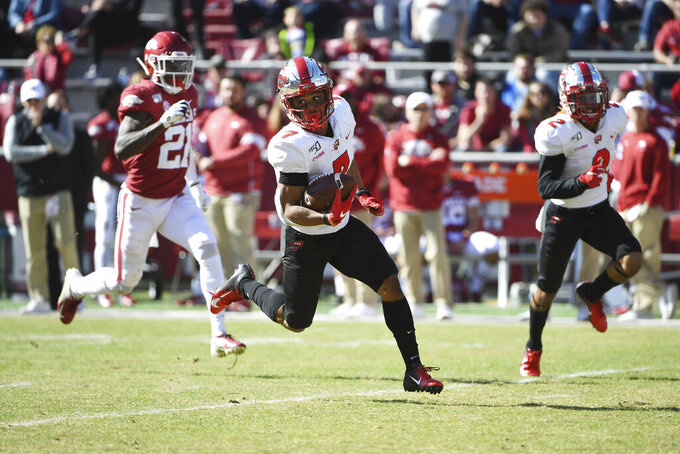 Western Kentucky receiver Jahcour Pearson (7) runs for a touchdown against Arkansas during the first half of an NCAA college football game, Saturday, Nov. 9, 2019, in Fayetteville, Ark. (AP Photo/Michael Woods)