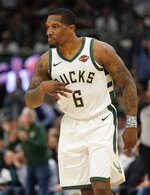 Milwaukee Bucks' Eric Bledsoe reacts to his three-point basket during the second half of Game 2 of a second round NBA basketball playoff series against the Boston Celtics Tuesday, April 30, 2019, in Milwaukee. The Bucks won 123-102 to tie the series at 1-1. (AP Photo/Morry Gash)