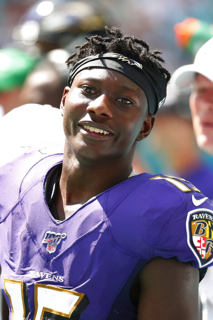 Baltimore Ravens wide receiver Marquise Brown (15) rests on the sidelines, during the second half at an NFL football game against the Miami Dolphins, Sunday, Sept. 8, 2019, in Miami Gardens, Fla. (AP Photo/Wilfredo Lee)