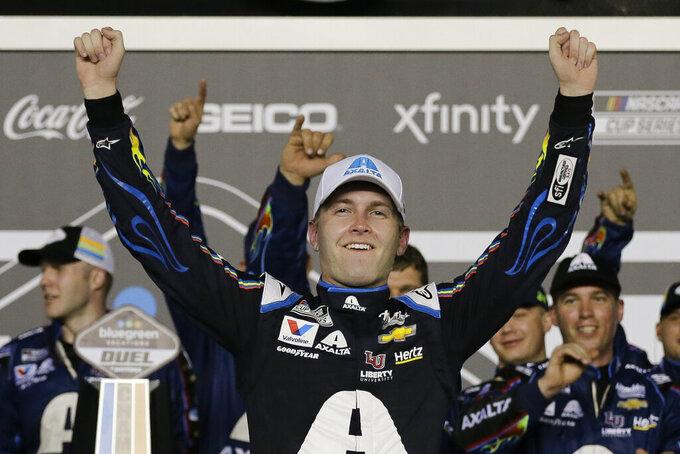 William Byron celebrates after winning the second of the two NASCAR Daytona 500 qualifying auto races at Daytona International Speedway, Thursday, Feb. 13, 2020, in Daytona Beach, Fla. (AP Photo/Terry Renna)