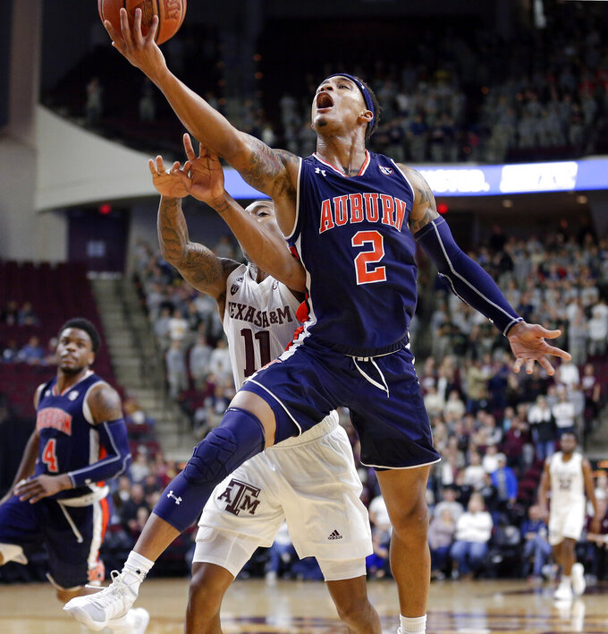 Auburn guard Bryce Brown (2) puts up a shot in front of Texas A&M guard Savion Flagg (1) during the second half of an NCAA college basketball game, Wednesday, Jan. 16, 2019, in College Station, Texas. (AP Photo/Michael Wyke)