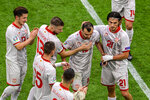 North Macedonia's Goran Pandev leaves the pitch while applauded and embraced by teammates during the Euro 2020 soccer championship group C match between The Netherlands and North Macedonia at the Johan Cruyff ArenA in Amsterdam, Netherlands, Monday, June 21, 2021. (Olaf Kraak, Pool via AP)