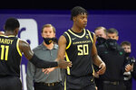 Oregon's Eric Williams Jr. (50) is congratulated by Amauri Hardy after scoring against Washington late in the second half of an NCAA college basketball game Saturday, Dec. 12, 2020, in Seattle. (AP Photo/Elaine Thompson)