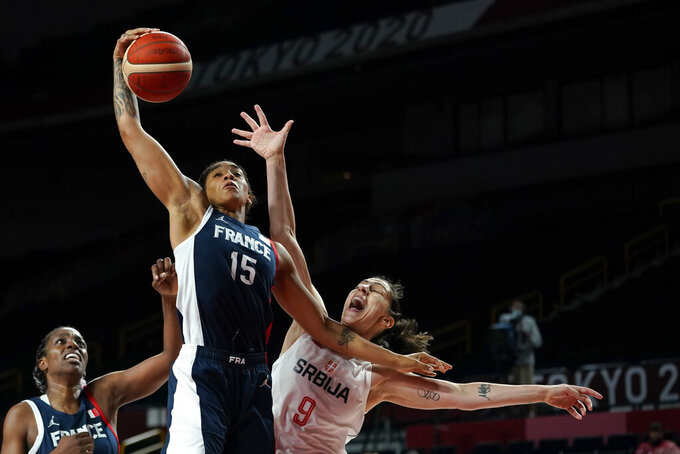 France's Gabrielle Williams (15) grabs a rebound over Serbia's Jelena Brooks (9) during the women's basketball bronze medal game at the 2020 Summer Olympics, Saturday, Aug. 7, 2021, in Saitama, Japan. (AP Photo/Charlie Neibergall)