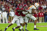 Alabama defensive backs Xavier McKinney (15) and Jared Mayden (21) drag down Tennessee wide receiver Jauan Jennings (15) during the first half of an NCAA college football game, Saturday, Oct. 19, 2019, in Tuscaloosa, Ala. (AP Photo/Vasha Hunt)