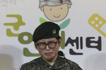South Korean army Sergeant Byun Hui-su weeps during a press conference at the Center for Military Human Right Korea in Seoul, South Korea, Wednesday, Jan. 22, 2020. South Korea's military decided Wednesday to discharge Byun who recently undertook gender reassignment surgery, a ruling expected to draw strong criticism from human rights groups.The sign reads