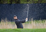 Rory McIlroy hits out of a bunker on the seventh hold during a practice round for the PGA Championship golf tournament, Tuesday, May 14, 2019, in Farmingdale, N.Y. (AP Photo/Julie Jacobson)