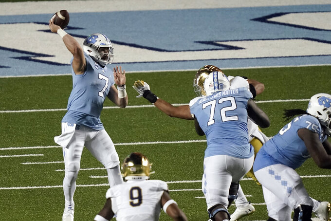 North Carolina quarterback Sam Howell (7) throws a pass against Notre Dame during the second half of an NCAA college football game in Chapel Hill, N.C., Friday, Nov. 27, 2020. (AP Photo/Gerry Broome)
