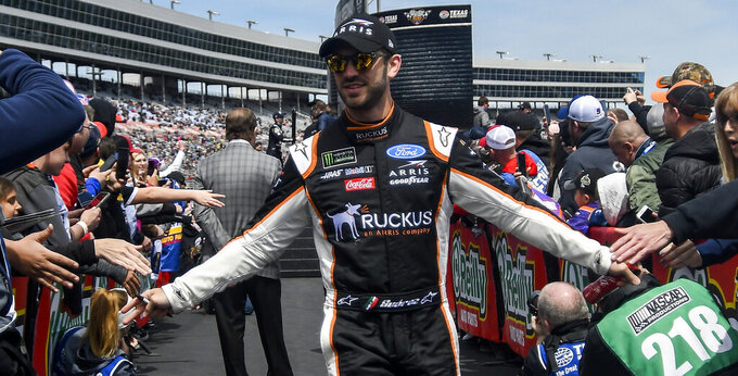 Driver Daniel Suarez greets fans before a NASCAR Cup auto race at Texas Motor Speedway, Sunday, March 31, 2019, in Fort Worth, Texas. (AP Photo/Randy Holt)