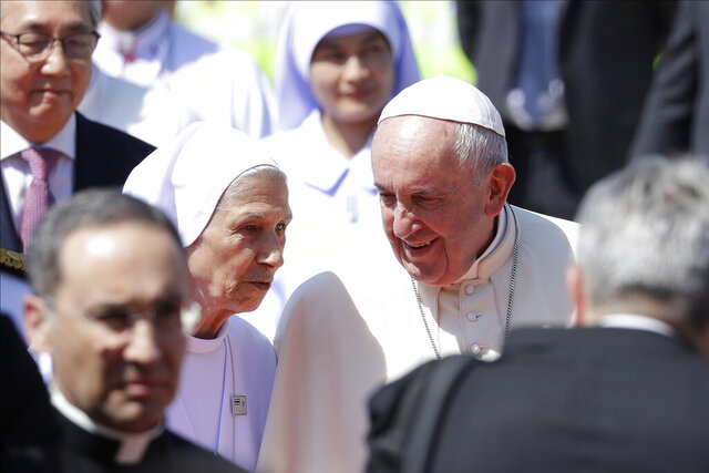 Pope Francis talks to his cousin Ana Rosa Sivori as he arrives at Military Air Terminal of Don Muang Airport, Wednesday, Nov. 20, 2019, in Bangkok, Thailand. (AP Photo/Gregorio Borgia)