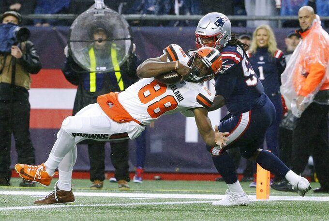Cleveland Browns tight end Demetrius Harris, left, scores a touchdown in front of New England Patriots linebacker Dont'a Hightower after catching a pass in the first half of an NFL football game, Sunday, Oct. 27, 2019, in Foxborough, Mass. (AP Photo/Steven Senne)