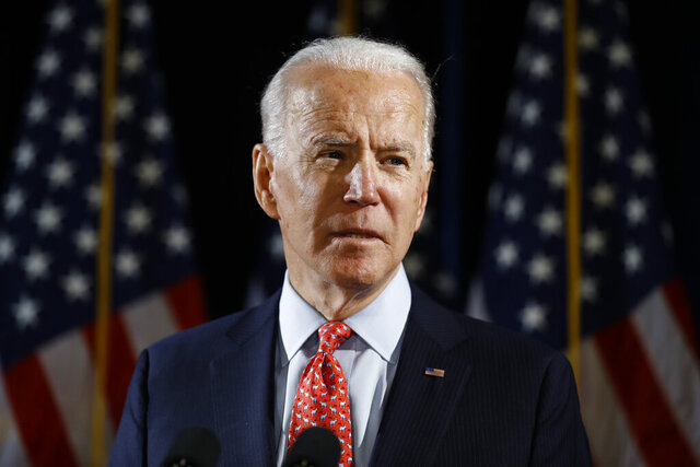 FILE - In this March 12, 2020 file photo, Democratic presidential candidate former Vice President Joe Biden speaks about the coronavirus in Wilmington, Del.  Biden overwhelmingly won a Democratic presidential primary in Kansas conducted exclusively by mail balloting by the state party because of the coronavirus pandemic. He had been expected to prevail in the vote Saturday, May 2 and capture a majority of the state's delegates to the Democrats' national nominating commission. Biden took 77% of the vote. (AP Photo/Matt Rourke, File)