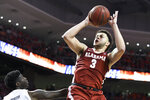 Alabama forward Alex Reese (3) shoots over Auburn forward Danjel Purifoy (3) during the first half of an NCAA college basketball game, Wednesday, Feb. 12, 2020, in Auburn, Ala. (AP Photo/Julie Bennett)