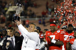 Ohio State coach Urban Meyer holds up the trophy after Ohio State defeated Washington 28-23 during the Rose Bowl NCAA college football game Tuesday, Jan. 1, 2019, in Pasadena, Calif. (AP Photo/Marcio Jose Sanchez)