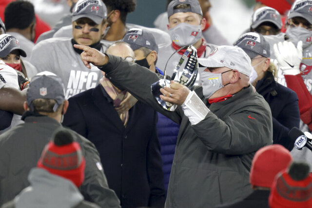 Tampa Bay Buccaneers head coach Bruce Arians holds the championship trophy after winning the NFC championship NFL football game against the Green Bay Packers in Green Bay, Wis., Sunday, Jan. 24, 2021. The Buccaneers defeated the Packers 31-26 to advance to the Super Bowl. (AP Photo/Matt Ludtke)
