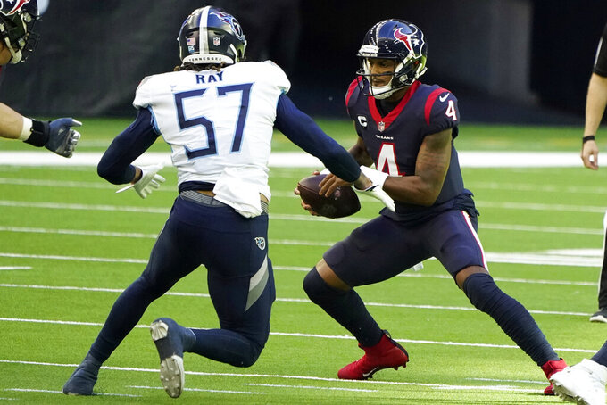 Houston Texans quarterback Deshaun Watson (4) scrambles out of the pocket as Tennessee Titans defensive end Wyatt Ray (57) defends during the first half of an NFL football game Sunday, Jan. 3, 2021, in Houston. (AP Photo/Eric Christian Smith)