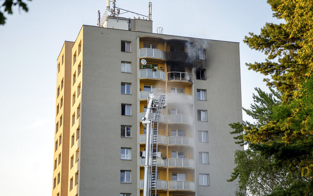 Firefighters battle a fire in an apartment building in Bohumin, northeastern Czech Republic, on Saturday, Aug. 8, 2020. At least 11 people have been killed in a fire in the apartment building police and firefighters said Saturday. Police said the fire hit the 11th floor of the 13-story building in the afternoon. (Vladimir Prycek/CTK via AP)