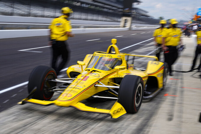 Helio Castroneves, of Brazil, leaves the pit area during practice for the Indianapolis 500 auto race at Indianapolis Motor Speedway in Indianapolis, Wednesday, Aug. 12, 2020. (AP Photo/Michael Conroy)