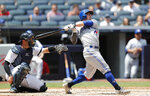 Toronto Blue Jays' Eric Sogard, right, follows through on his swing as he watches his fifth-inning, solo home run during a baseball game against the New York Yankees, Sunday, July 14, 2019, in New York. Yankees catcher Austin Romine in behind the plate. (AP Photo/Kathy Willens)