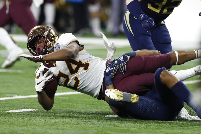 Minnesota running back Mohamed Ibrahim (24) is stopped during the first half of the Quick Lane Bowl NCAA college football game against Georgia Tech, Wednesday, Dec. 26, 2018, in Detroit. (AP Photo/Carlos Osorio)