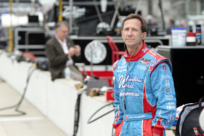 FILE - In this May 19, 2010, file photo, John Andretti watches during practice for the Indianapolis 500 auto race at the Indianapolis Motor Speedway in Indianapolis. Andretti, a member of one of racing's most families, has died following a battle with colon cancer, Andretti Autosports announced Wednesday, Jan. 30, 2020. He was 56.  (AP Photo/AJ Mast, File)