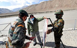 In this handout photo provided by the Press Information Bureau, Indian Prime Minister Narendra Modi interacts with soldiers during a visit to the Ladakh area, India, Friday, July 3, 2020. Modi made an unannounced visit Friday to a military base in remote Ladakh region bordering China where the soldiers of the two countries have been facing off for nearly two months. Modi's visit comes in the backdrop of massive Indian army build-up in Ladakh region following hand-to-hand combat between Indian and Chinese soldiers on June 15 that left 20 Indian soldiers dead and dozens injured, the worst military confrontation in over four decades between the Asian giants. (Press Information Bureau via AP)