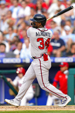 Atlanta Braves' Abraham Almonte follows through on a two-run single during the third inning of the team's baseball game against the Philadelphia Phillies, Saturday, July 24, 2021, in Philadelphia. (AP Photo/Chris Szagola)