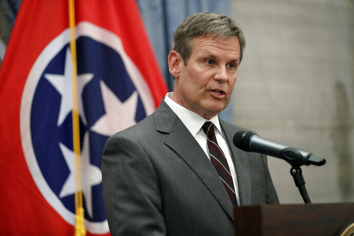 FILE- In this Nov. 7, 2018 file photo, Governor-elect Bill Lee speaks during a news conference in the Capitol in Nashville, Tenn.  Lee said he will direct his legal counsel to investigate whether Tennessee's most populated county is following a new law that prohibits local authorities from requiring a warrant or probable cause before complying with federal immigration detainers. Earlier this month, the Shelby County Sheriff's Office said it won't detain anyone being released from jail without a warrant or probable cause because the county attorney advised that the new law doesn't apply to them.  (AP Photo/Mark Humphrey, File)