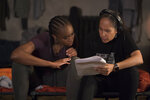 This image released by Netflix shows actress Kiki Layne, left, with director Gina Prince-Bythewood during the filming of