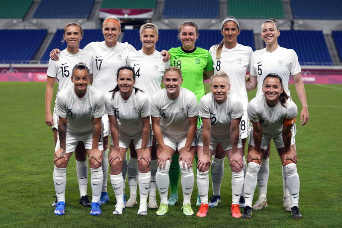 New Zealand players pose for a team photo prior to a women's soccer match against the United States at the 2020 Summer Olympics, Saturday, July 24, 2021, in Saitama, Japan. (AP Photo/Martin Mejia)
